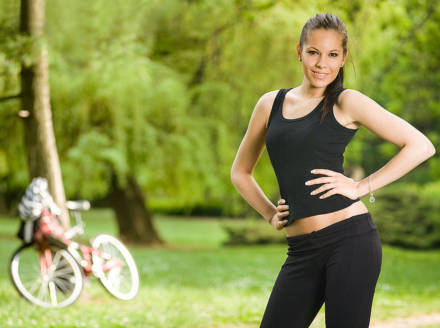 Gorgeous young fitness brunette posing outdoors.
